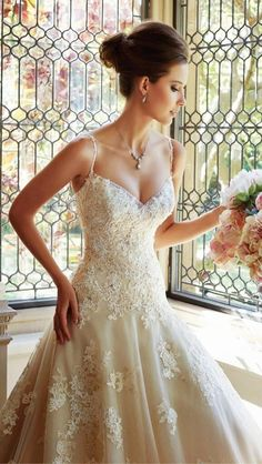 Spaghetti strap, beaded with intricate floral design. I love this dress.