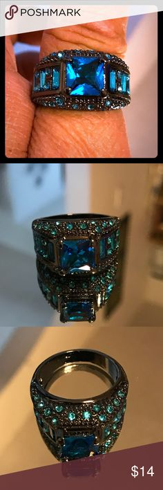 ❤️ Brand New Blue Topaz Ring Brand new 18K, black gold filled blue topaz ring. This ring has rows of topaz rhinestones on both sides of the band ring and along both sides. The center stone is a large square. It is a size 9. This is the perfect gift for that someone special. I paid $39.99 for this ring. It looks very expensive. The pictures don't do this ring justice.  ❤️ Part of the Pick (3) for $25.00. Jewelry Rings