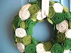 http://www.etsy.com/listing/91017483/felt-and-yarn-wreath-olive-green-oatmeal