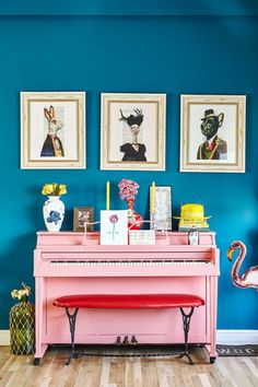 Love the contrast of the piano against the blue wall! Although, I would not put so much stuff on the piano.