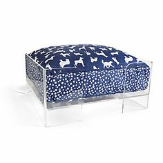 Miscellaneous - Clear dog bed frame with brass accents. Dog bed holds a geometric pattern blue and white cushion.