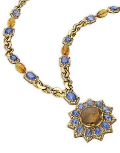 18 Karat Gold, Sapphire, Citrine and Diamond Pendant-Necklace, Bulgari Supporting a pendant in the form of a sunburst, set with alternating citrines and sapphires, accented by round diamonds weighing approximately 12.15 carats, gross weight approximately 228 dwts, the necklace separates into two segments measuring 21½ and 12½ inches for variety of wear, the pendant signed Bulgari; circa 1970.