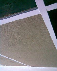 Acoustic ceiling for basement- instead of dropped ceiling grid, install wood beams and then cover drop ceiling tiles in burlap and pop in. Drop Ceiling Tiles, Dropped Ceiling, Ceiling Chandelier, Chandeliers, Ceiling Panels, Basement Ceiling Options, Basement Lighting, Basement Ideas, Dark Basement