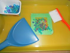 Spill the beads all over in the tray, have the child use the brush to comb all the beads into the square then they practice using a dust pan to sweep the beads on the pan and carefully pouring them back into the container! (Great eye-hand coordination and fine motor skills practice!)