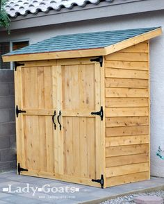 Small Cedar Fence Picket Storage Shed- We could build this to match the house and make it big enough for the lawn / garden stuff.  Much cheaper and nicer than a storage building.