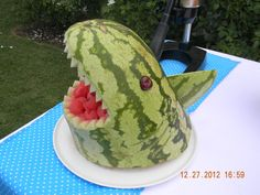 """Watermelon shark for a party, but make it """"bloodier"""" with smashed watermelon pieces dripping from its jaws. Yeah, that will be yummy."""