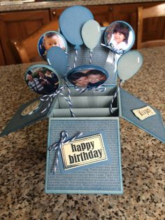 Card in a box with photos on balloons. Like idea of putting family pics into the balloons