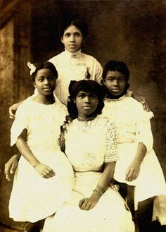 A young marian anderson at center with her sisters and mother. - Google Search