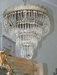 I have a similar one, different crystals and repainted oil rubbed bronze. Silver Chandelier, Chandelier Lamp, Chandeliers, Shabby Chic Homes, Cottage Chic, Oil Rubbed Bronze, Light Fixtures, Antique Silver, Wedding Cakes