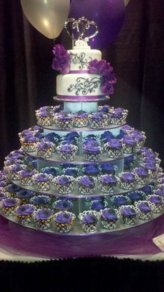 so what do you think about the cupcake tower, but with a little cake on top for tradition? More from my site purple turquoise cupcake tower Fondant Cupcakes, Purple Cupcakes, Wedding Cakes With Cupcakes, Purple Wedding Cakes, Cool Wedding Cakes, Cupcake Tower Wedding, Wedding Cake Toppers, Purple Sweet 16, Birthday Cakes