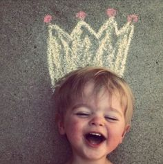 little boy laughing with chalk crown