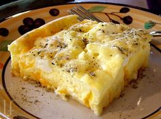 CHEESY EGG BAKE I just love this dish!  It's very soft and fluffy - eggy, cheesy, light.  You could add any seasonings you had on hand - even some cooked broccoli, green peppers, cooked sausage. A ...