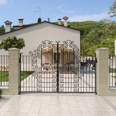 Classic wrought iron gate project for a villa near Lyon. #lyon #villa #gate #wroughtiron #wroughtironfence #classic #door #entrance #France #architecture #luxurydesign #designs #metalwork #italian #madeinitaly #handforged #garden #grass #sky