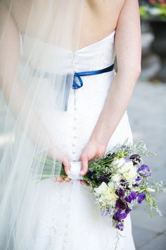 Love this #wedding #photography #beautiful #bouquet #behind #the #bride Photography by @amychesh   See more here: http://amycheshire.com/wedding-gallery-toronto-weddings