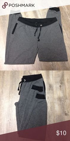 NWT GREY Sweat Pants Sz Large NWT Grey Sweat Pants with Black accents. Drawstring waist for a comfortable fit. Cuffed leg, 2 side pockets. Cotton/Polyester mix for a Comfy yet Stretchy Fit ! Tag says XL but runs small in my opinion so I'm listing as a large. CoCo Limon Pants Track Pants & Joggers