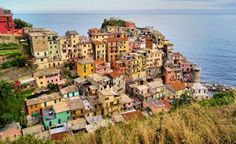 """Manarola, Italy  Manarola is the oldest of the Italian towns known as the Cinque Terre—the Five Lands along the country's northwestern coast that cling, lichen-like, to the rugged rocks above the Ligurian Sea. All five localities—Riomaggiore, Manarola, Corniglia, Vernazza, and Monterosso al Mare—are part of a UNESCO World Heritage Site recognized for its """"harmonious interaction between people and nature."""" UNESCO obviously knows its color wheel: The sea's rich blues complement the…"""