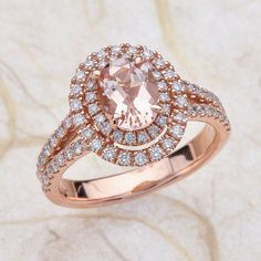 14kt Rose Gold Double Halo Split Shank Diamond Engagement Ring1.25 ctw G-SI2 Quality Diamonds And A 2ct Oval Pink Morganite  Center