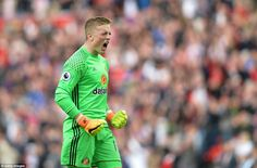 Sunderland goalkeeper Jordan Pickford roars in celebration of Defoe's second strike for Mo...