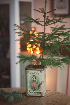 I have a beautiful tin just like this. Using it for a Christmas tree is a wonderful idea! Must try next time. #home #winter