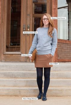 That hair! Grey sweater, brown skirt, black tights, black brogues/oxfords, red hair