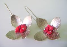 Flower alpaca metal forged earrings with red chips
