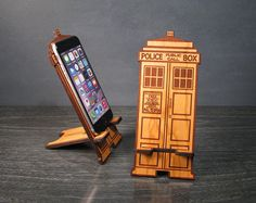 A TARDIS phone stand! This awesome wood phone stand/dock is laser-etched and cut into the shape of a Doctor Who TARDIS. Not only functional, its gonna look awesome on your desk even when its not in use. The easy to use, two-piece design sets up in an instant to hold your smartphone while you video chat, update your Facebook status, check your email, watch TV or simply charge your phone. We designed this to be the perfect size for the iPhone 6 and Galaxy but it would work fine as a phone ...