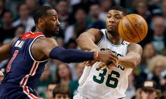"""Marcus Smart says he benched himself for Celtics in Game 1 = Boston Celtics guard Marcus Smart was on the floor during the fourth quarter of Sunday's Game 1 matchup against the Washington Wizards, until he decided he no longer should be there. Smart made the decision to bench himself in the game's final moments, as the Celtics held on for a 123-111 victory. """"I just decided to….."""
