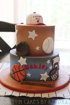 Sports-themed shower cake welcoming baby oakley