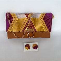 Pochette en similicuir marron et wax par Doranels pour Afrikrea. https://www.afrikrea.com/article/pochette-en-tissu-africain-wax-pochettes-marron-similicuir-wax/X3E42P7?utm_content=buffer517cc&utm_medium=social&utm_source=pinterest.com&utm_campaign=buffer