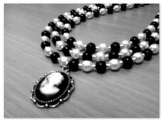 Black & white glass pearls with cameo pendant