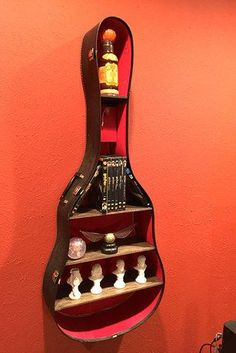 Guitar Case Shelf | 23 Borderline Genius Ways To Upcycle Your Junk #GuitarCase