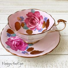 Idr 2.380 Paragon with gold leaves pink roses in very good condition.