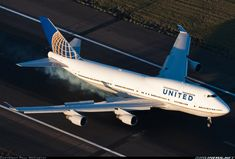 Airliners.net ‏- A top down view of a United 747 smoking the mains on arrival Sydney Airport