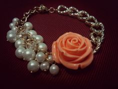 Beautiful link bracelet with bunch of pearls and rose motif