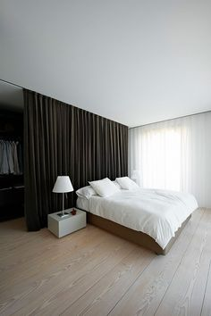 Use a thick, heavy curtain as a room divider and/or to add texture/variation to a design.