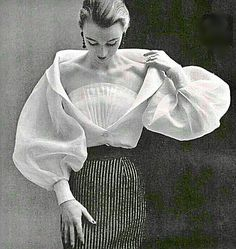 Balenciaga, such an interesting chiffon style. I have a pleated gray and black chiffon blouse that my Grandma wore in the 1920's with the smallest black pearl buttons and I typically wear it with large white (14-16mm) pearls on New Year's eve. To this day