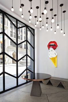 Tucked away between two looming New York City buildings on W30th is Rafael  de Cardenas' latest renovation project: the Black Ocean Firehouse.