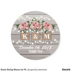 Rustic Burlap Mason Jar Wedding   Roses Monogram Classic Round Sticker Stylish rustic wedding personnalized stickers with a light gray rustic wood background, string twinkle lights, three pink rose mason jars with burlap wrapped around them, you and your partners initials printed on the jam jars and trendy white wording.