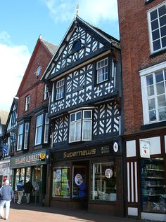 The Queen's Aid House is a timber-framed, black-and-white Elizabethan merchant's house in Nantwich, Cheshire, England. Built shortly after the fire of 1583 by Thomas Cleese, a local craftsman, it has three storeys with attics, & features ornamental panelling, overhangs or jetties at each storey, & a 19th-century oriel window. The building is best known for its contemporary inscription commemorating Elizabeth I's aid in rebuilding the town, which gives the building its name.