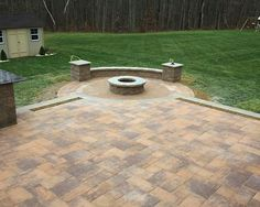 Share stories around your Cambridge fire pit. Entertain friends and family in the comfort of your own backyard; Cambridge Pavingstones with ArmorTec makes this possible! Installation: Stone and Patio Pros