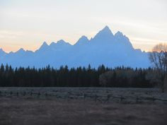 Do not know why the Tetons appear to be glowing, was running to catch them as the sun was setting, by Kathy O'Day