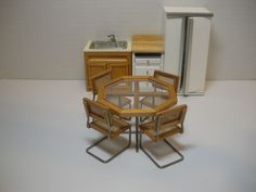 Sold for  $40.00 dollhouse modern caned chairs. I wish I had won the auction since this has been pinned 8 times since I pinned it.