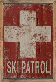 Wooden ski patrol sign framed out in reclaimed wood. Distressed styled art . Approx. 14x20x3/4 inches. Handmade. Metal hanger on back. The wood
