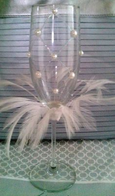Wedding Toasting Champagne Flutes White Pearl with Glitter, Bead & Feather Accent by LillianMarieDesigns on Etsy