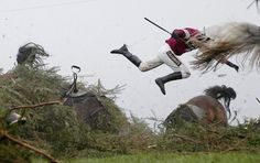 Sports, First Prize, Singles—<i>Grand National Steeplechase</i>: Jockey Nina Carberry flies off her horse, Sir Des Champs, as they fall at The Chair fence during the Grand National steeplechase, during day three of the Grand National Meeting at Aintree Racecourse on April 9, 2016, in Liverpool, England.