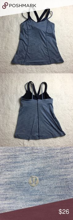 Lululemon attached bra workout tank This is a bluish grey Lululemon tank. It has spaghetti straps with a cross back built in (attached) sports bra. Size 8 size dot verified! I ❤️ offers! lululemon athletica Tops
