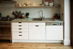 Formica drawer fronts incorporating grab handles with birch ply and Formica work top made for family in North London