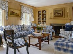 lovely traditional furniture:  butler's tray table, hitchcock chair, brass candlesticks, wing chair, ladies' chair, tufted ottoman, swag and jabot curtains