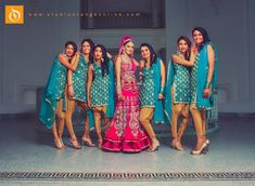 Bridesmaid suits are unique and cool. Love their poses and the turquoise color contrast from the bride's lehenga. Funny Wedding Poses, Indian Wedding Poses, Indian Wedding Photographer, Sikh Wedding, Punjabi Wedding, Wedding Suits, Indian Bridal, Wedding Lenghas, Indian Weddings