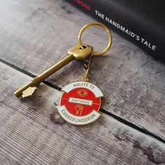 Nolite Te Bastardes Carborundorum Keyring The Handmaids Tale Enamel Keychain Dystopian Literature Collection Book Lover Feminist by LiteraryEmporium Funny Comic Strips, Margaret Atwood, Friends Tv, Classic Books, Book Cover Design, Cool Items, Book Lovers, Literature, Personalized Items